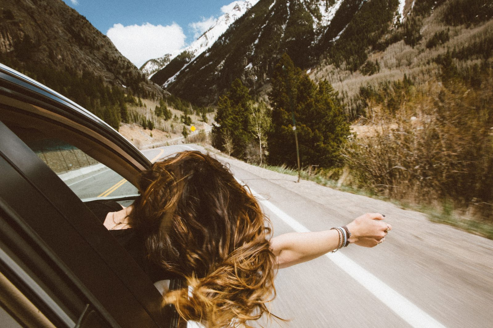 A woman enjoying her road trip